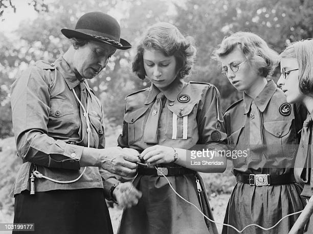 Princess Elizabeth learns to tie a knot with the girl guides in Frogmore Windsor England on April 11 1942