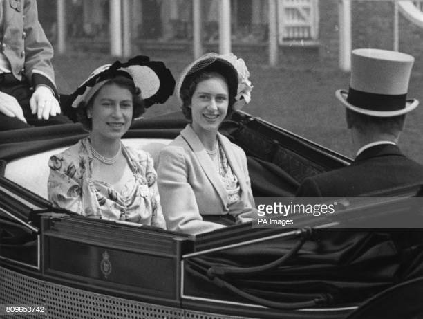Princess Elizabeth left and Princess Margaret as they arrived at the grandstand for the third day of the Ascot race meeting