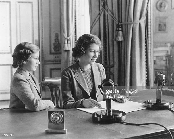 Princess Elizabeth makes her first broadcast accompanied by her younger sister Princess Margaret Rose October 12 1940 in London Buckingham Palace...