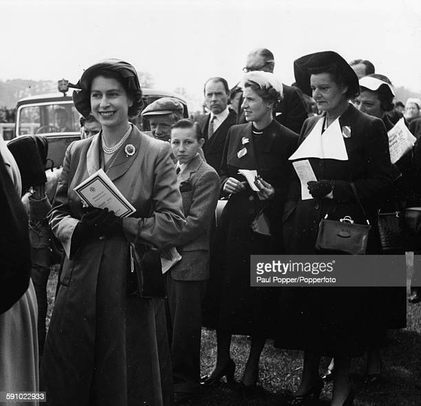 Princess Elizabeth mixes with the crowds of people enjoying the Derby week race meeting at Epsom Downs, England, June 13th 1951.