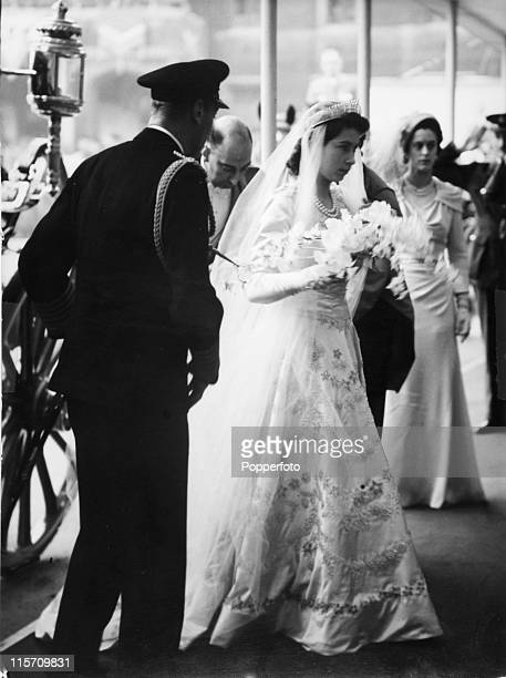 Princess Elizabeth now Queen Elizabeth II arrives with her father King George VI for her wedding to Prince Philip at Westminster Abbey London on 20th...