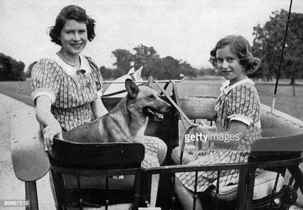 Princess Elizabeth of England and her sister princess Margaret in gradens of Windsor, 1941