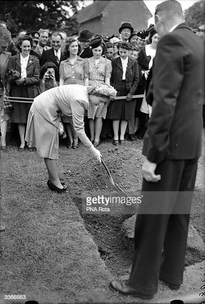 Princess Elizabeth plants a tree in the grounds of Grendon Hall the new County Youth Centre of Northamptonshire to commemorate the opening of the...