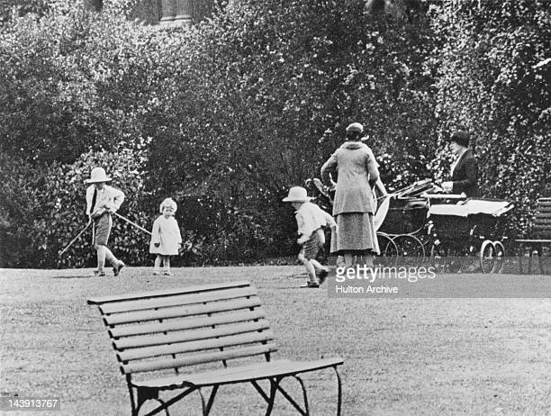 Princess Elizabeth playing with her cousins George and Gerald Lascelles, circa 1929.