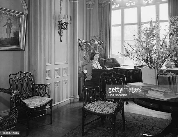 Princess Elizabeth plays the piano at the Royal Lodge in Windsor Castle England on April 11 1942