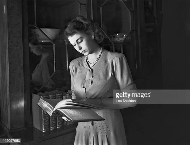 Princess Elizabeth reading a book in Buckingham Palace on July 19, 1946.