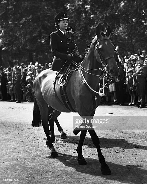 Princess Elizabeth returns to Buckingham Palace on horseback after attending the 1947 Trooping the Colour Ceremony