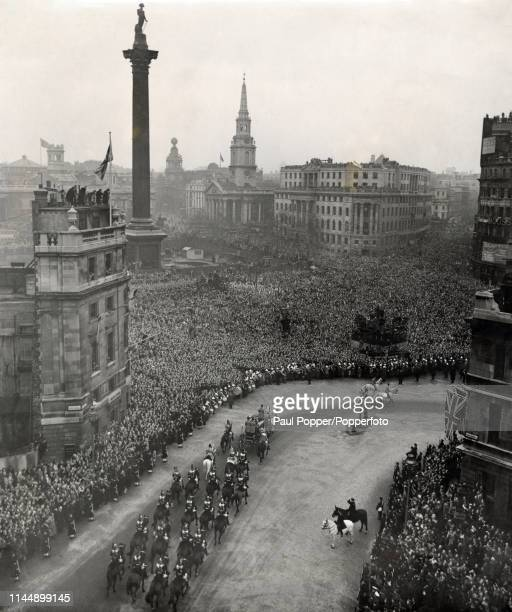 Princess Elizabeth rides through the streets of London lined with crowds of cheering people in procession to Westminster Abbey in London and her...