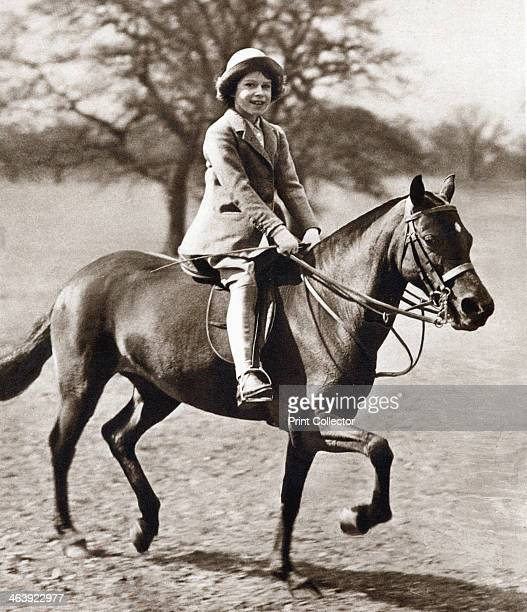 Princess Elizabeth riding her pony in Winsor Great Park, 1930s. The future Queen Elizabeth II of Great Britain as a child.