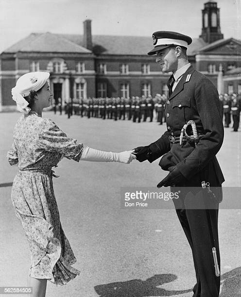 Princess Elizabeth shaking hands with FC Under Officer B A Spry as she presents him with the Medal of Honor at the Passing Out Parade at the Royal...