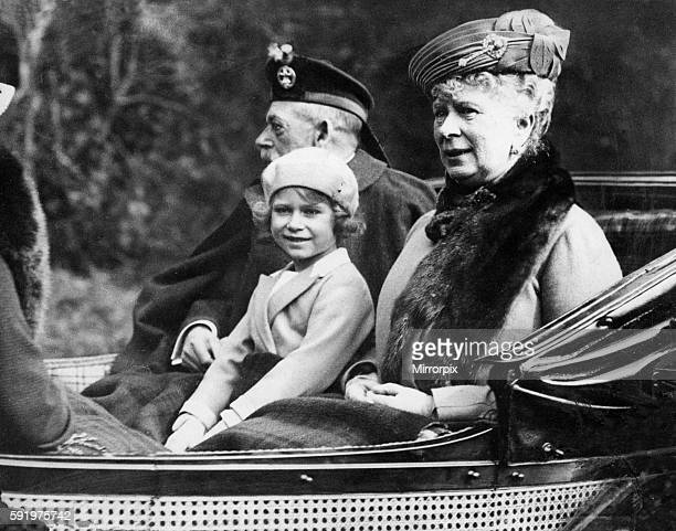 Princess Elizabeth sitting in the horse drawn carriage with her grandparents King George V and Queen Mary on the way back to Balmoral after attending...