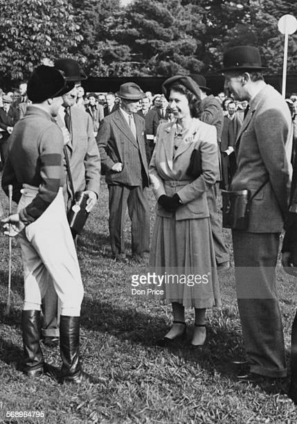 Princess Elizabeth standing next to Lord Mildmay talking to jockey Anthony Grantham at Fontwell Park October race meeting West Sussex October 11th...