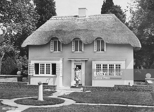 Princess Elizabeth stands in the doorway of Y Bwthyn Bach , situated in the grounds of the Royal Lodge, Windsor, June 1933. The cottage was a gift to...