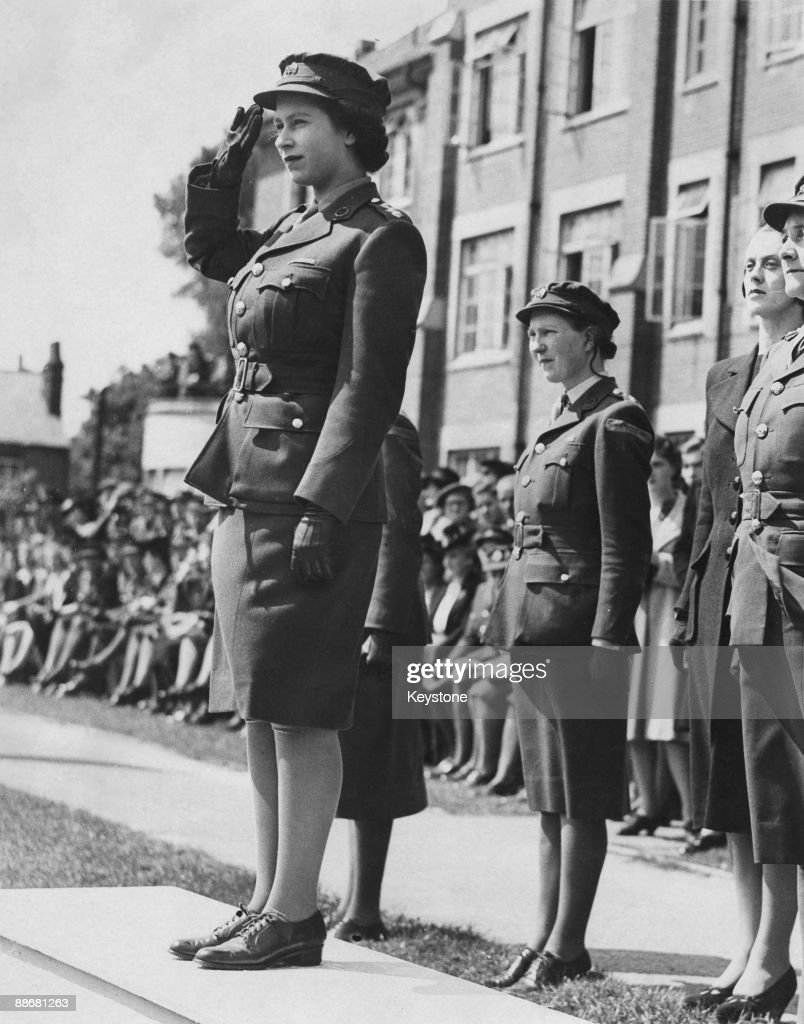 Princess Elizabeth (now Queen Elizabeth II) takes the salute during a march-past of A.T.S. (Auxiliary Territorial Service) cadets at the Imperial Services College, Windsor, 14th June 1946.