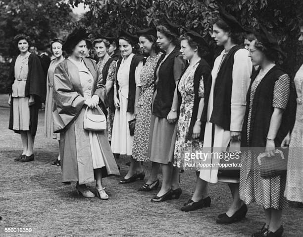Princess Elizabeth talks to a group of exservice undergraduates after receiving her honorary civil law degree at St Hilda's College in Oxford May...