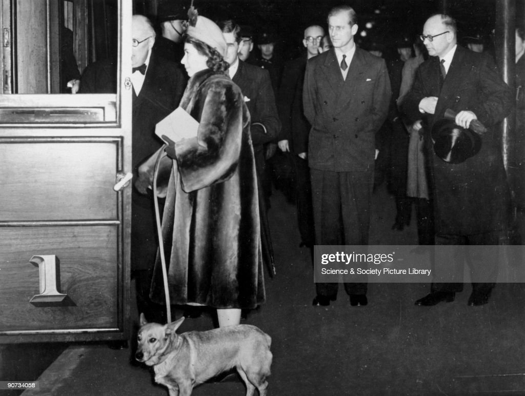 Princess Elizabeth, together with her pet corgi, board the Royal Train at Kings Cross. It is likely that this journey was made to Edinburgh on 28 February to 4 March 1949, and that the Duke of Edinburgh accompanied his wife.