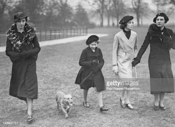 Princess Elizabeth walking her dog in Hyde Park London 26th February 1936 She is accompanied by her governess Marion Crawford