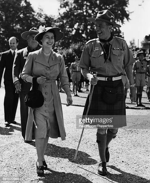 Princess Elizabeth walks with the Chief Scout Thomas Corbett Lord Rowallan during her review of contingents from the British Commonwealth attending...