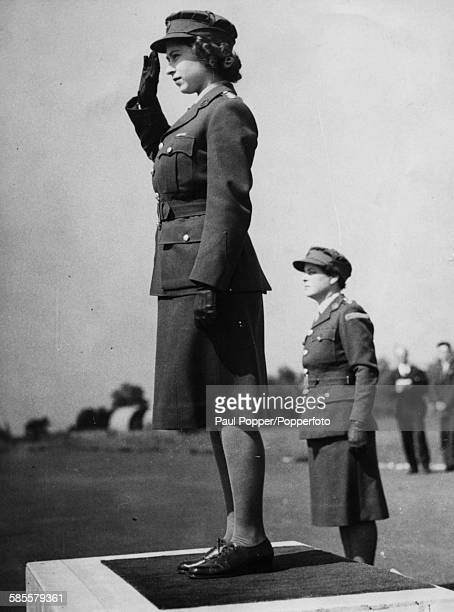Princess Elizabeth wearing an ATS officers uniform as Junior Commander, takes the salute of a group of her former training companions at the...