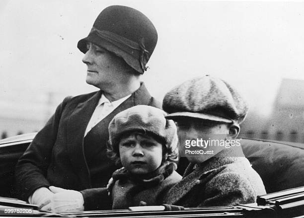 Princess Elizabeth, with George Lascelles, the son of Princess Mary, go for a drive at Windsor Palace, accompanied by a nanny, London, England, April...