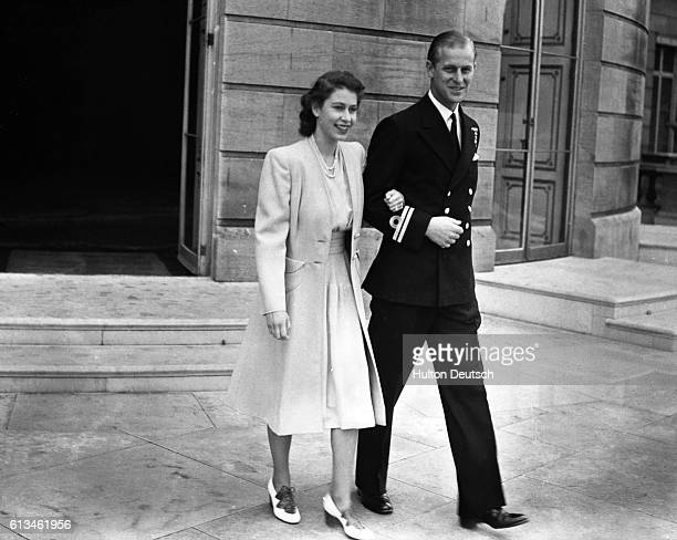 Princess Elizabeth with her fiancee Lieutenant Phillip Mountbatten at Buckingham Palace after the announcement of their engagement by her father the...