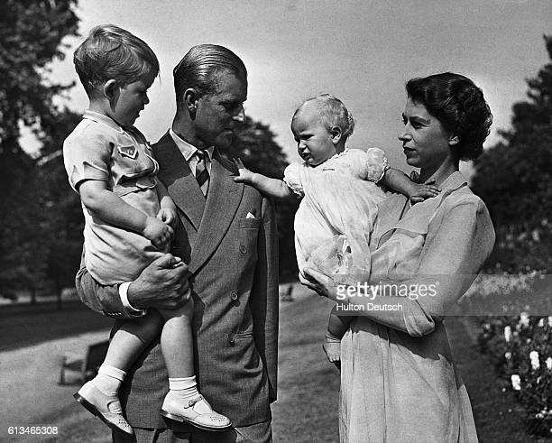 Princess Elizabeth with her husband Philip, son Charles and daughter Anne. She is the future Queen Elizabeth II of England.