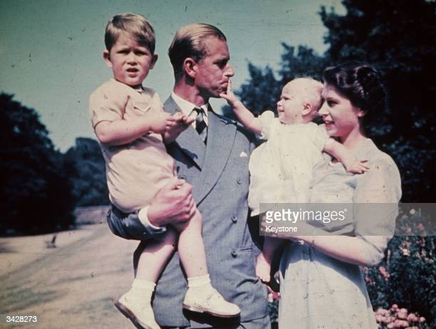 Princess Elizabeth with her husband Prince Philip, Duke of Edinburgh, and their children Prince Charles and Princess Anne, August 1951.