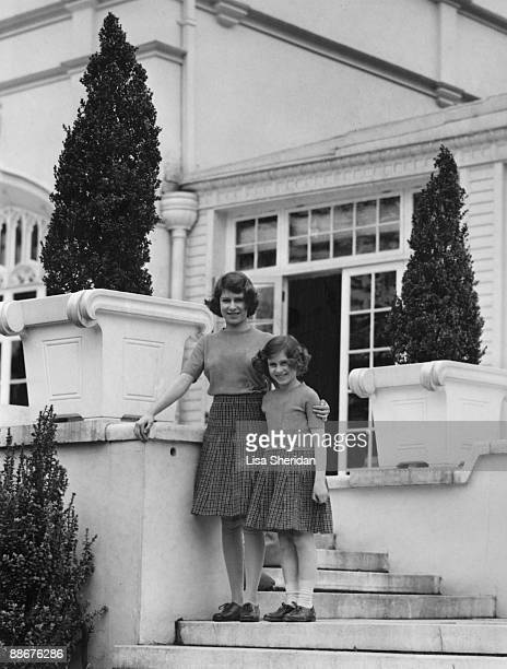 Princess Elizabeth with her younger sister Princess Margaret Rose on the terrace steps at the back of the Royal Lodge in Windsor Great Park April 1940