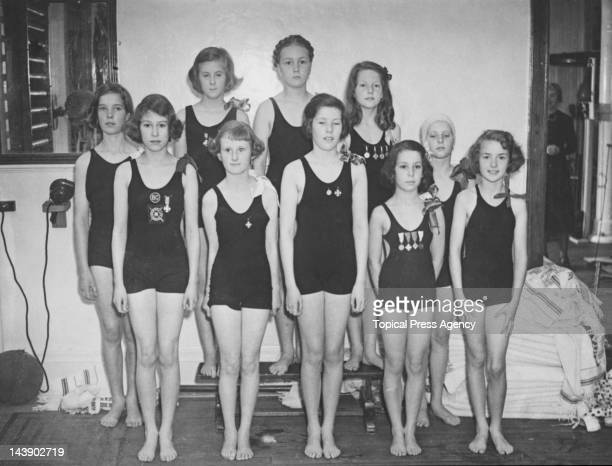 Princess Elizabeth with the rest of the Challenge Cup swimming team at the Bath Club, 34 Dover Street, London, 28th June 1939. Back row, left to...