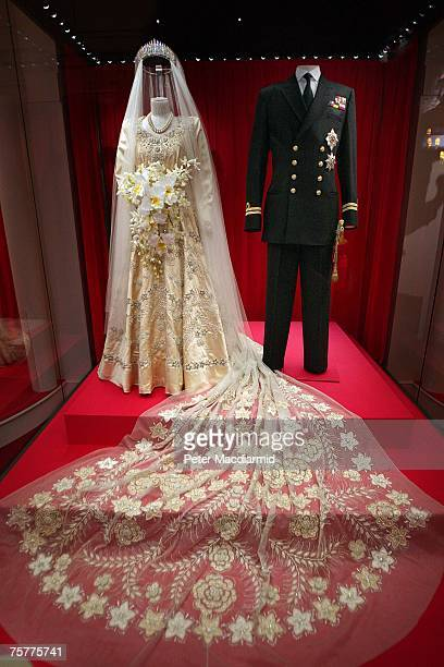 Princess Elizabeth's wedding dress designed by Norman Hartnell and the Duke of Edinburgh's Royal Naval uniform are displayed at the 'Royal Wedding 20...