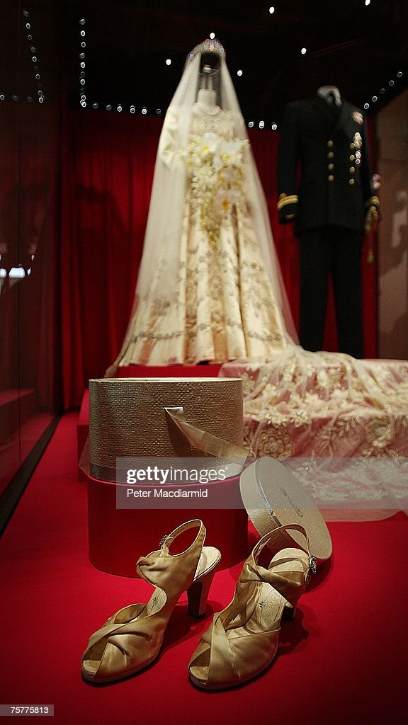 Princess Elizabeth's wedding dress, designed by Norman Hartnell, and the Duke of Edinburgh's Royal Naval uniform are displayed at the 'Royal Wedding: 20 Novermber 1957' exhibition at Buckingham Palace on July 27, 2007 in London. Queen Elizabeth II will be the first reigning sovereign to celebrate a 60th wedding anniversary. This new exhibition will mark the occasion by recreating the day in 1947 when Princess Elizabeth married The Duke of Edinburgh at Westminster Abbey. The collection of archive film footage, behind the scenes preparations, dresses, jewels and gifts reflect the mood of public rejoicing that swept the nation in the immediate aftermath of World War II.