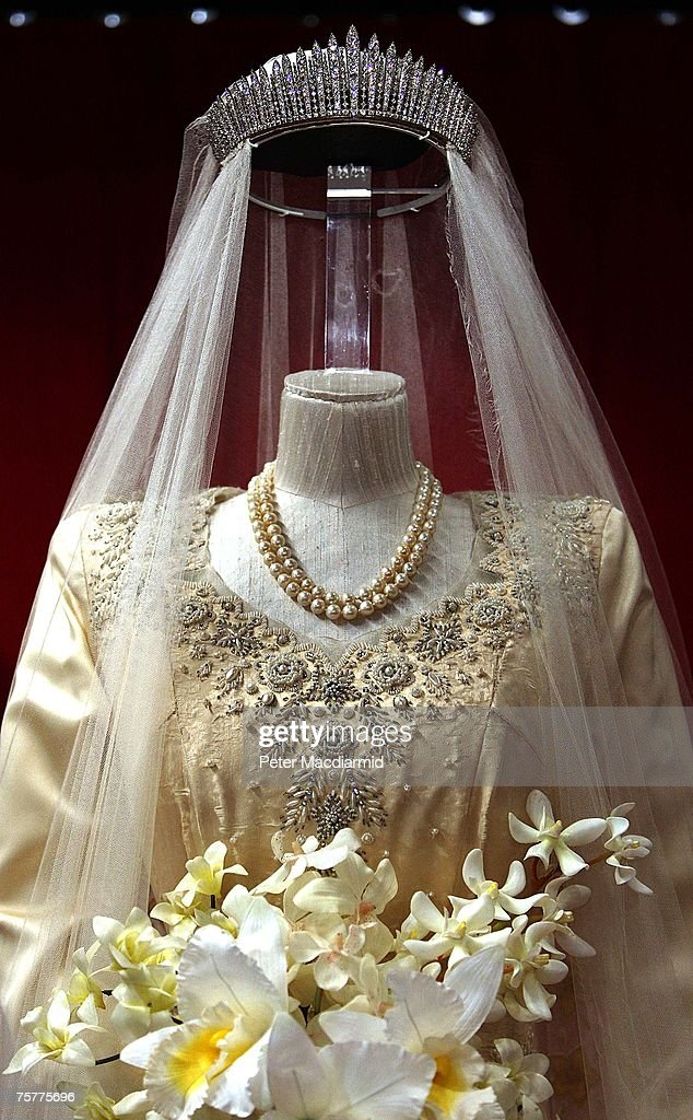 Princess Elizabeth's wedding dress, designed by Norman Hartnell, is displayed at the 'Royal Wedding: 20 Novermber 1957' exhibition at Buckingham Palace on July 27, 2007 in London. Queen Elizabeth II will be the first reigning sovereign to celebrate a 60th wedding anniversary. This new exhibition will mark the occasion by recreating the day in 1947 when Princess Elizabeth married The Duke of Edinburgh at Westminster Abbey. The collection of archive film footage, behind the scenes preparations, dresses, jewels and gifts reflect the mood of public rejoicing that swept the nation in the immediate aftermath of World War II.