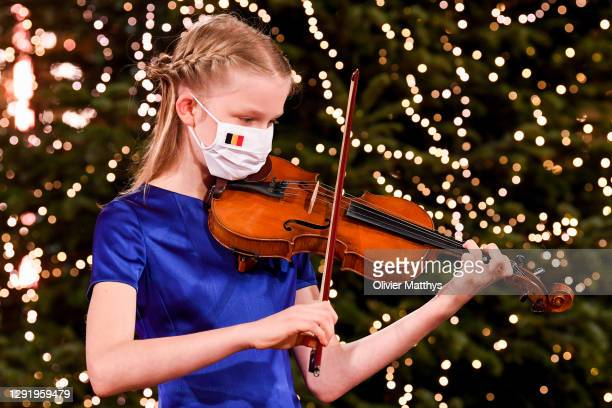 Princess Eléonore of Belgium plays the violin in a string quartet with the Scala Choir during the Christmas concert at the Royal Palace on December...