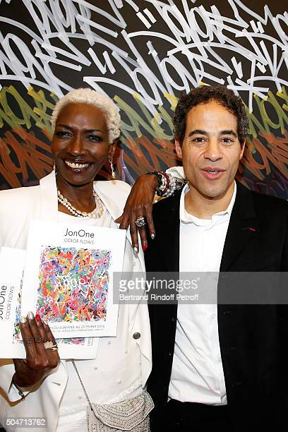 Princess Esther Kamatari du Burundi and Artist JonOne pose in front of a work JonOne has just realized in Live during the Guerlain collaboration with...