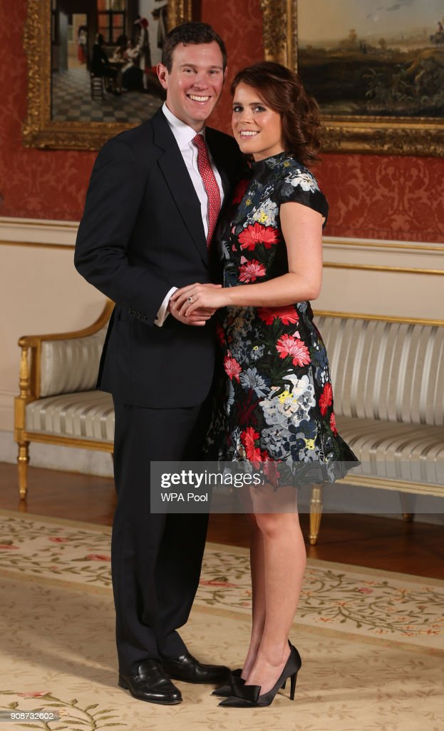 Princess Eugenie and Jack Brooksbank in the Picture Gallery at Buckingham Palace after they announced their engagement. Princess Eugenie wears a dress by Erdem, shoes by Jimmy Choo and a ring containing a padparadscha sapphire surrounded by diamonds on January 22, 2018 in London, England.. They are to marry at St George's Chapel in Windsor Castle in the autumn this year.