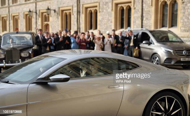 Princess Eugenie and Jack Brooksbank leave Windsor Castle in an Aston Martin DB10 after their wedding for an evening reception at Royal Lodge on...