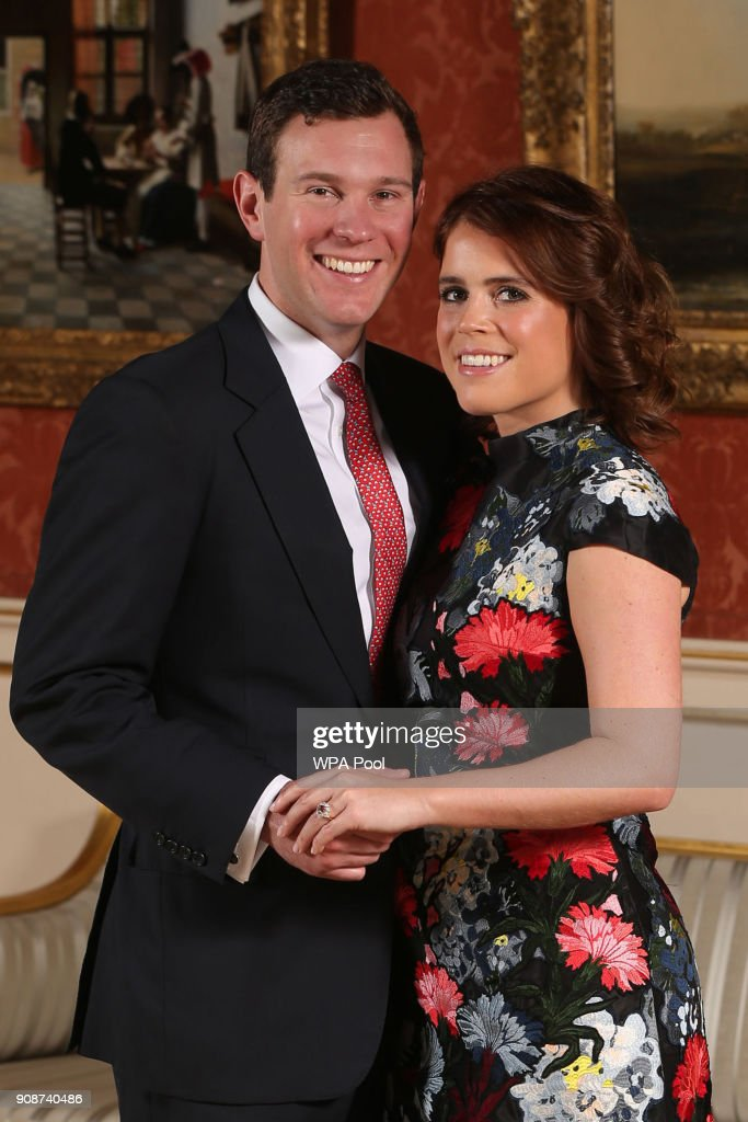 Princess Eugenie and Jack Brooksbank pose in the Picture Gallery at Buckingham Palace after they announced their engagement. Princess Eugenie wears a dress by Erdem, shoes by Jimmy Choo and a ring containing a padparadscha sapphire surrounded by diamonds on January 22, 2018 in London, England.. They are to marry at St George's Chapel in Windsor Castle in the autumn this year.