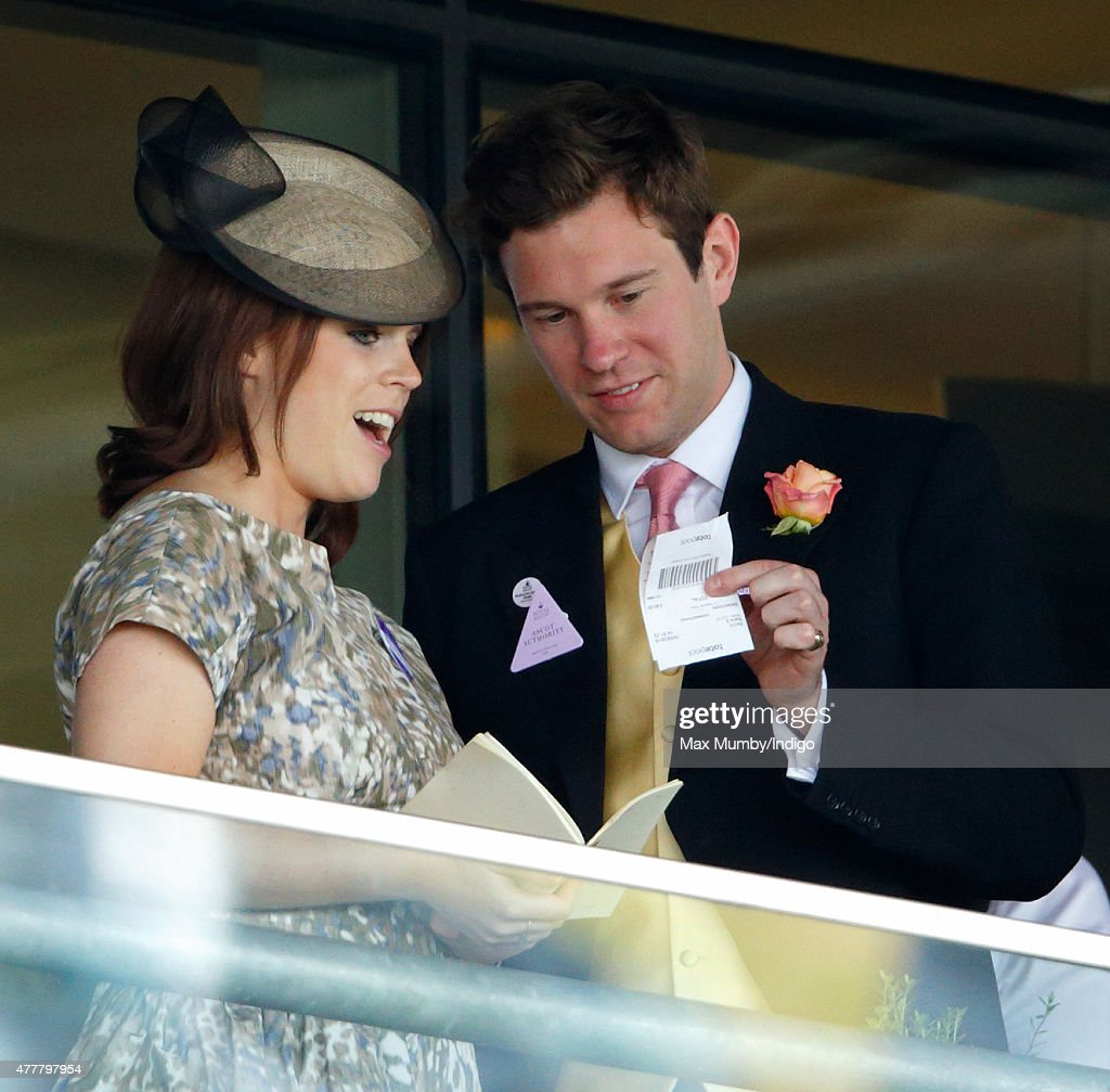 Princess Eugenie and Jack Brooksbank (holding a betting slip) watch the racing as they attend day 4 of Royal Ascot at Ascot Racecourse on June 19, 2015 in Ascot, England.