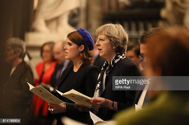 Princess Eugenie and Prime Minister Theresa May sing during a service to commemorate the work of William Wilberforce and mark the United Kingdom's...