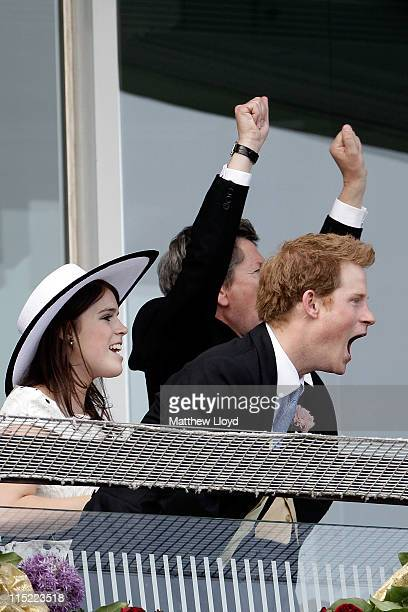 Princess Eugenie and Prince Harry react as the Queen's horse Carlton House comes in third in the Epsom Derby at Epsom Downs racecourse on June 4,...