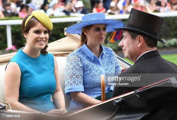 Princess Eugenie and Princess Beatrice arrive in an open carriage to attend day one of Royal Ascot on June 18 2019 in Ascot England