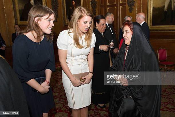 Princess Eugenie and Princess Beatrice speak with Princess Sabeeka of Bahrain during a reception in the Waterloo Chamber before the Lunch For...
