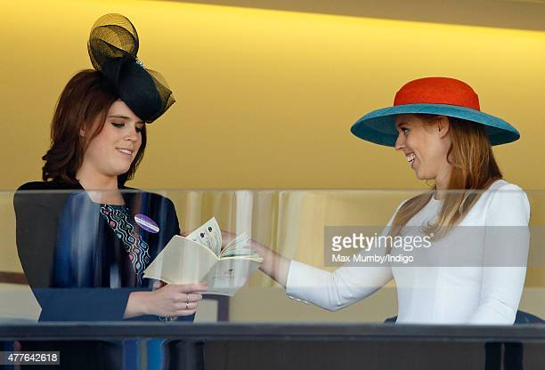 Princess Eugenie and Princess Beatrice watch Queen Elizabeth II's horse 'Dartmouth' run in The King George V Stakes on day 3 Ladies Day of Royal...