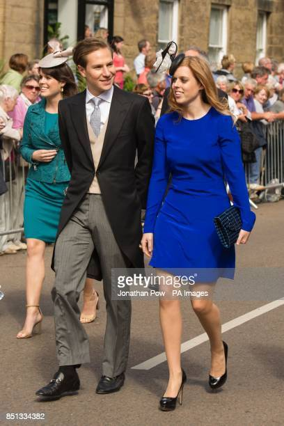 Princess Eugenie and Princess Beatrice with her boyfriend Dave Clark arrive for the wedding between the Duke of Northumberland's daughter Lady...