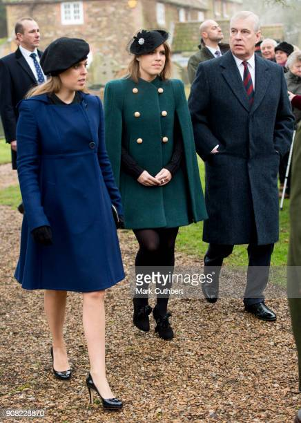 Princess Eugenie and Princess Beatrice with Prince Andrew Duke of York arrive at St Lawrence Church on January 21 2018 in Castle Rising England