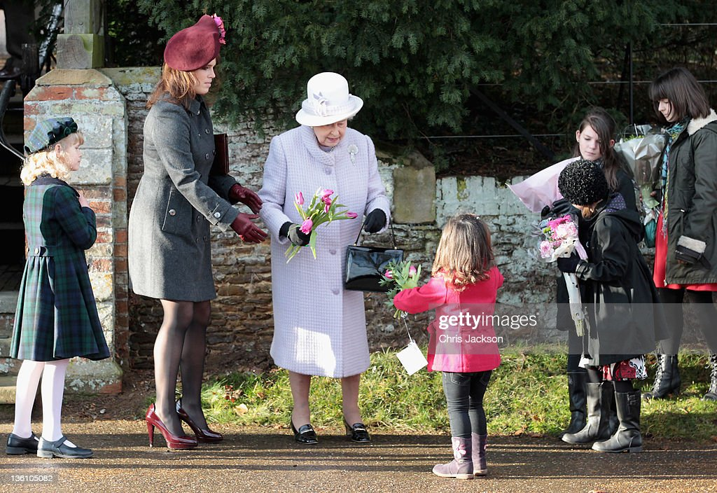 Princess Eugenie and Queen Elizabeth II accept flowers from children outside Sandringham Church after the traditional Christmas Day service at Sandringham on December 25, 2011 in King's Lynn, England. The Queen and the Duke of Edinburgh traditionally lead the royals in attending a church service at Sandringham Church on Christmas Day. It is the Duchess of Cambridge's first Christmas at Sandringham after her marriage to Prince William, Duke of Cambridge in April of this year. This year the Duke of Edinburgh mised the service as he is in Papworth Hospital after having cardiac surgery to fit a stent in his coronary artery.