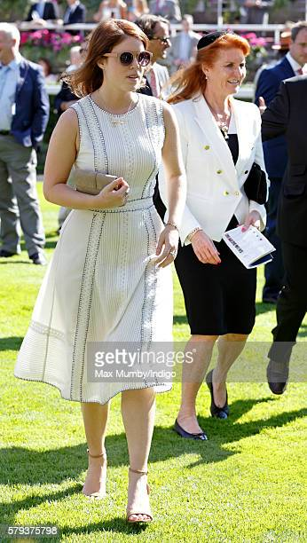 Princess Eugenie and Sarah Ferguson Duchess of York attend the King George VI Weekend at Ascot Racecourse on July 23 2016 in Ascot England