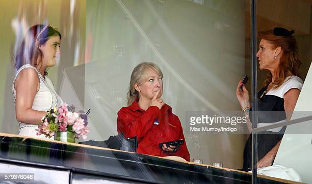 Princess Eugenie and Sarah Ferguson Duchess of York place a bet as they attend the King George VI Weekend at Ascot Racecourse on July 23 2016 in...