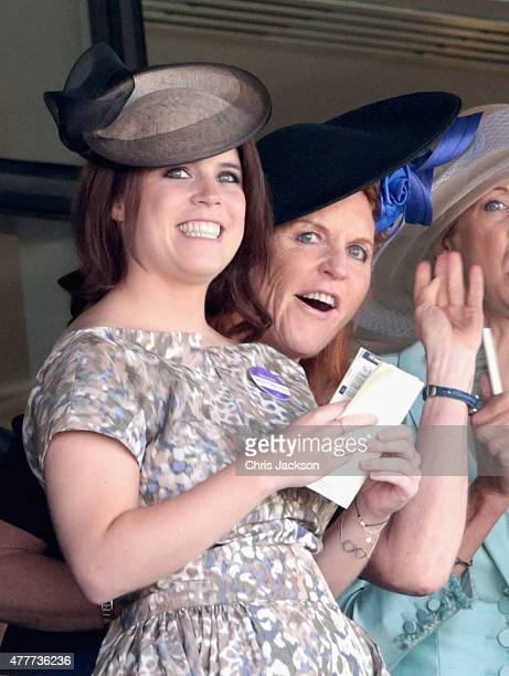 Princess Eugenie and Sarah Ferguson Duchess of York wait for the result of a race on day 4 of Royal Ascot at Ascot Racecourse on June 19 2015 in...