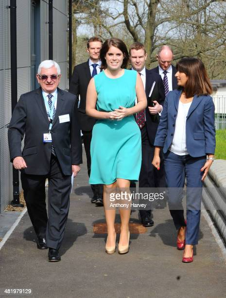 Princess Eugenie is greeted as she arrives by Professor Anthony Goldstone and Rosy Stolarski as she meets staff and patients during a visit to Royal...